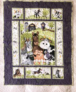 Barnyard Buddies Quilt Kit, show on top of another quilt